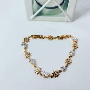 Gorgeous Gold Plated bracelet/ Wheels